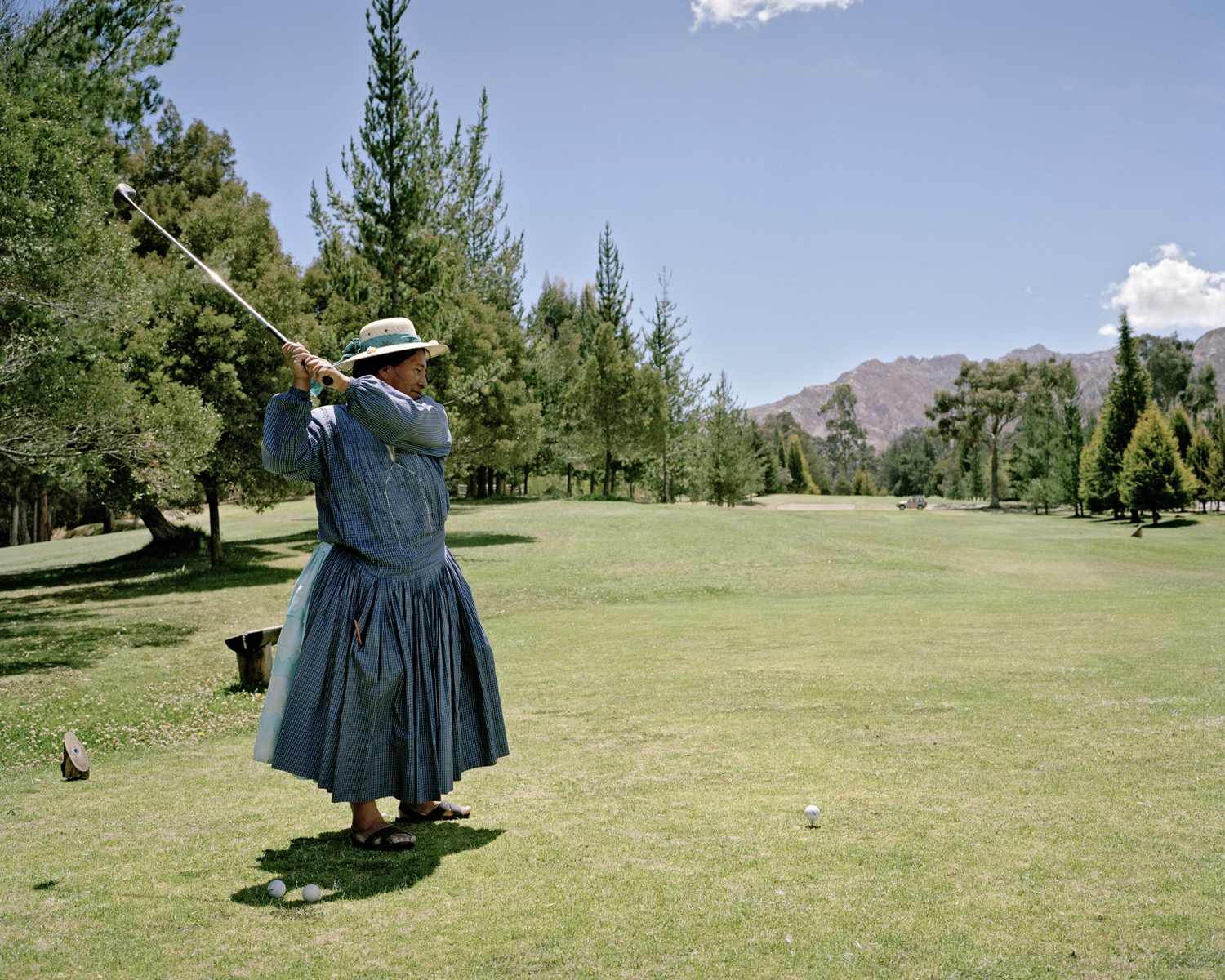 Teresa : Teresa is working at the Golf-Club of La Paz.  Usually she couldn´t afford to play Golf. It is a privilege of the sparcely rich people in Bolivia. La Paz, Bolivia 24.10.2007