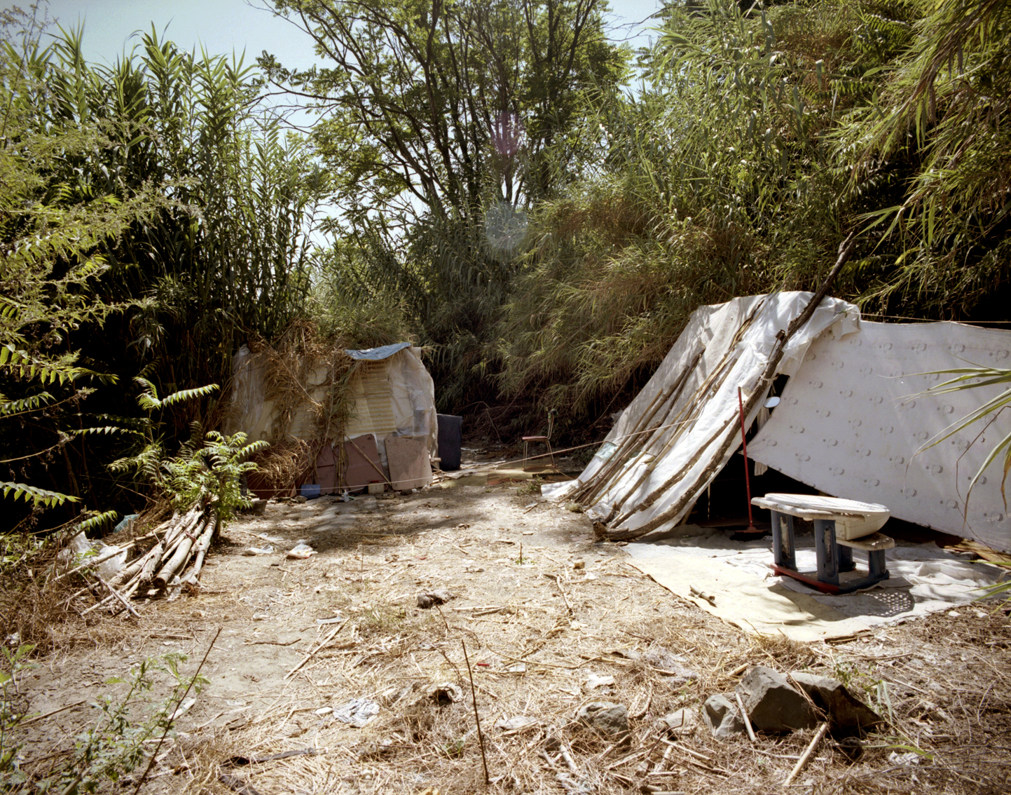 Hidden camp in Rome : Hidden camp realized by illegal immigrants, along Aniene river's banks in Rome.