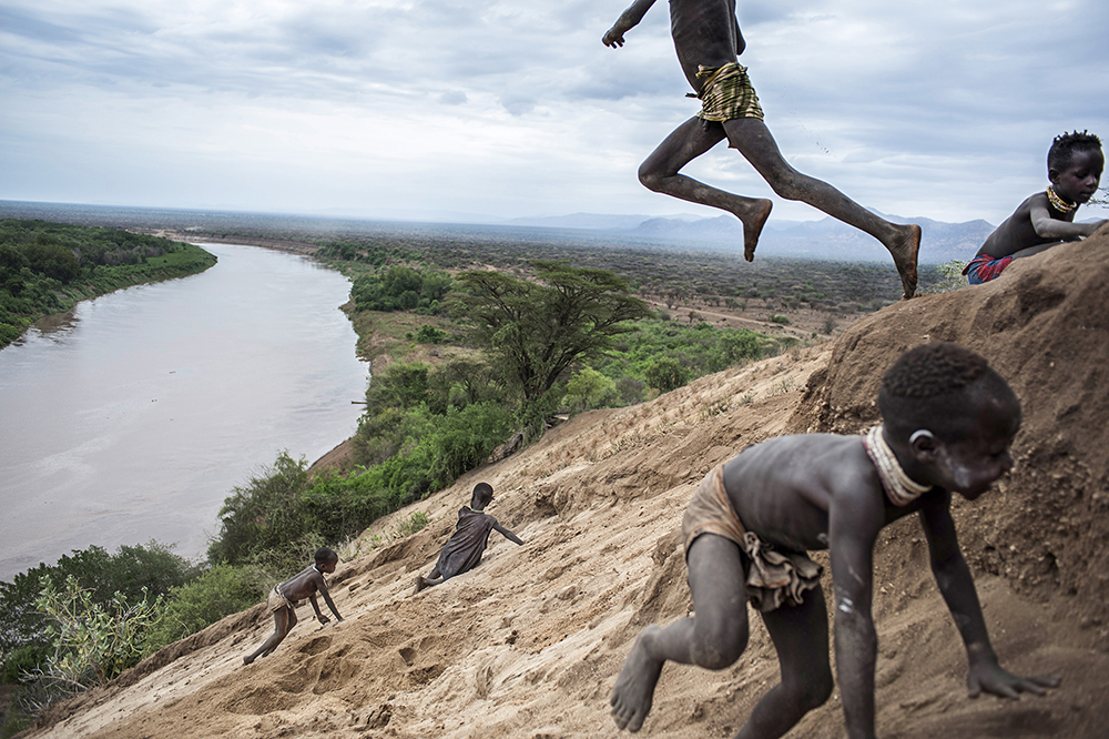 Biggest Dam : Children of the tribe of Karo. The waters of the Omo River are a source of life for thousands of indigenous people who live in South-Western Ethiopia and in Northern Kenya.