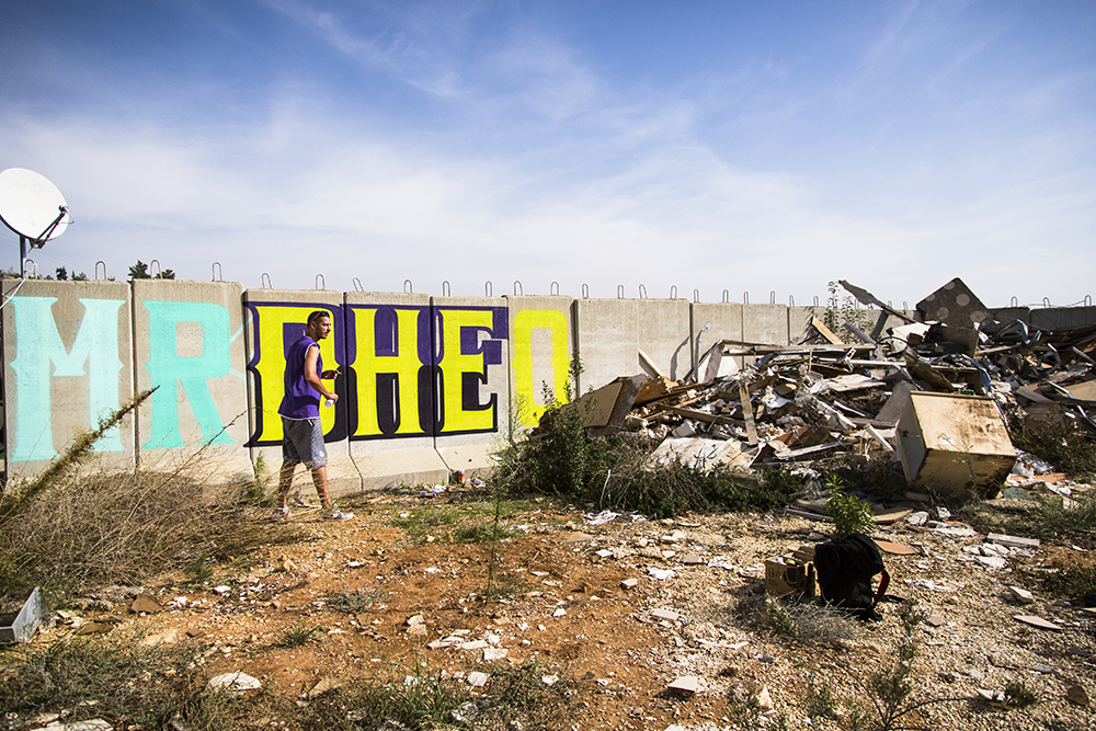 5. Creating Beauty in Places of Destruction : Artist, Mr. Dheo, adds some color at a school for troubled girls in the West Bank.