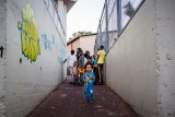 6. Involving the Community : At the end of the day, the artists give some paint cans to the kids of the Ethiopian community in Netanya, Israel so that they can add their own artwork.