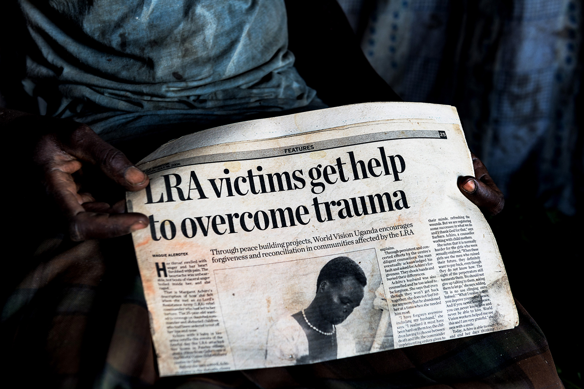 Life after Kony : The story of  thousands of victims that lost lives, dignity and hope in Northern Uganda due the endless war  - 1987 | 2006 -  between the LRA, the Lord's Resistance Army of Joseph Kony and the official UPDF troops.…no real justice, recognition, acceptance, help and compensation seem to be in view. Victim holding a newspaper publication.