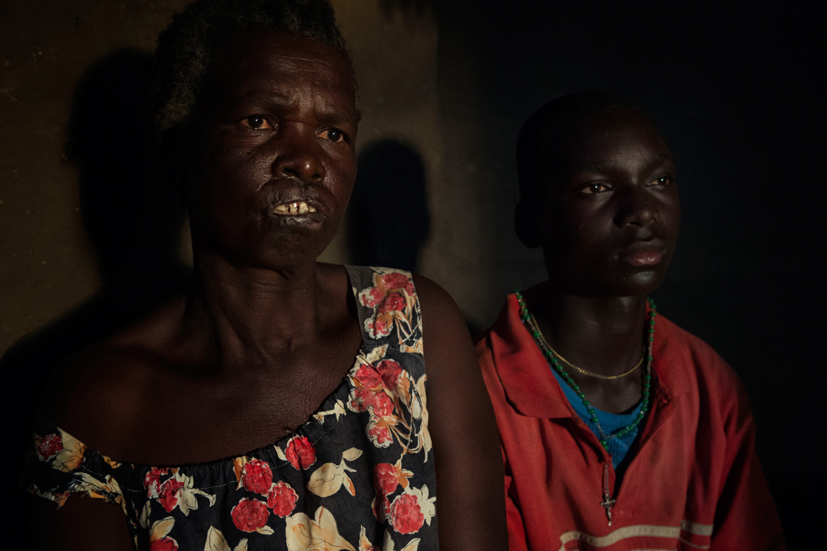 Life after Kony : Nekolina | 61 | widow. On 24.8.2003 during an ambush operation at her homestead, her husband and the only 3 sons got butchered to death. Then she was mutilated and speared by a bayonet.