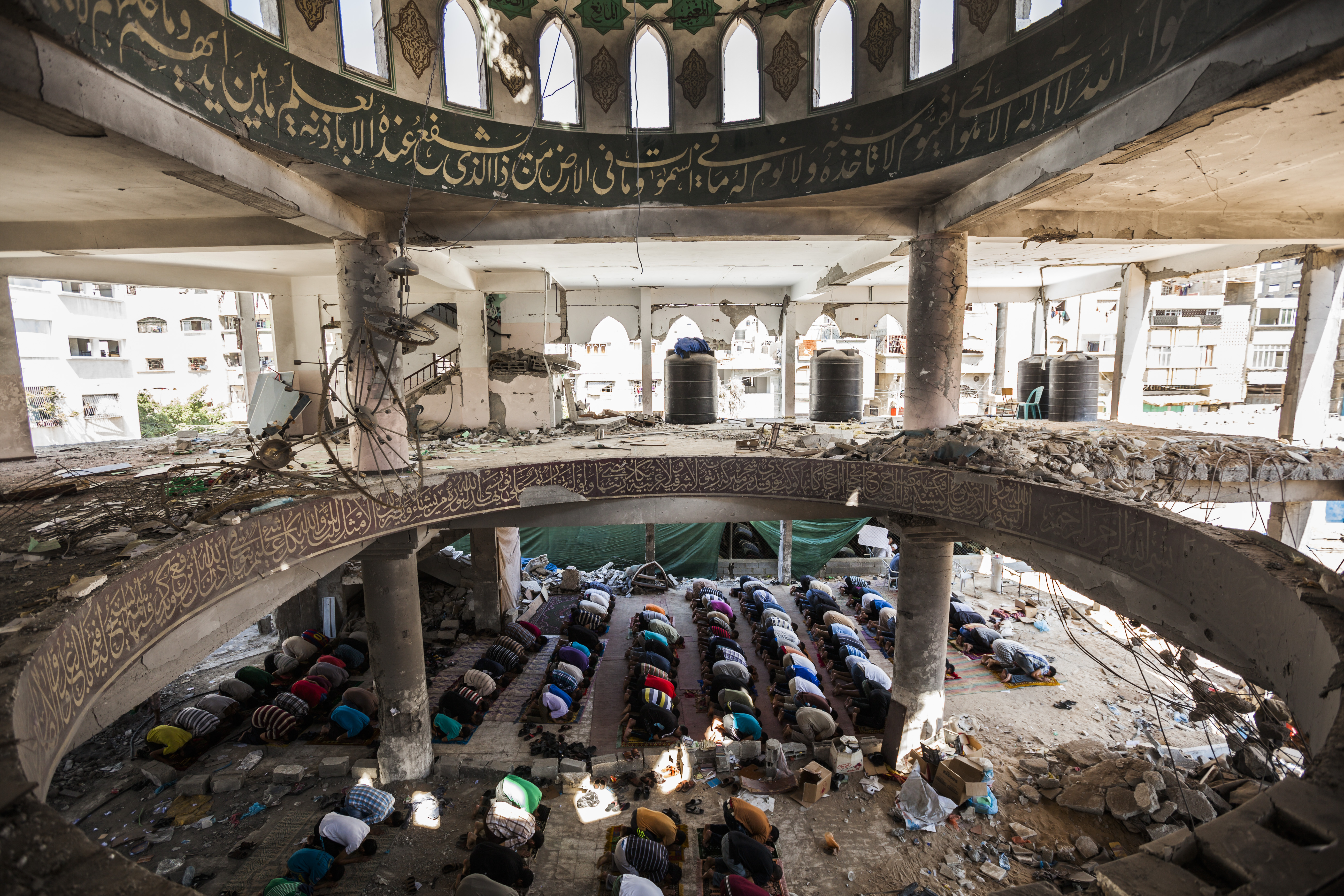 Destroyed mosques in Gaza after the last war against israel : Prays in a destroyed mosque in Gaza during the Eid al-Adha celebrations