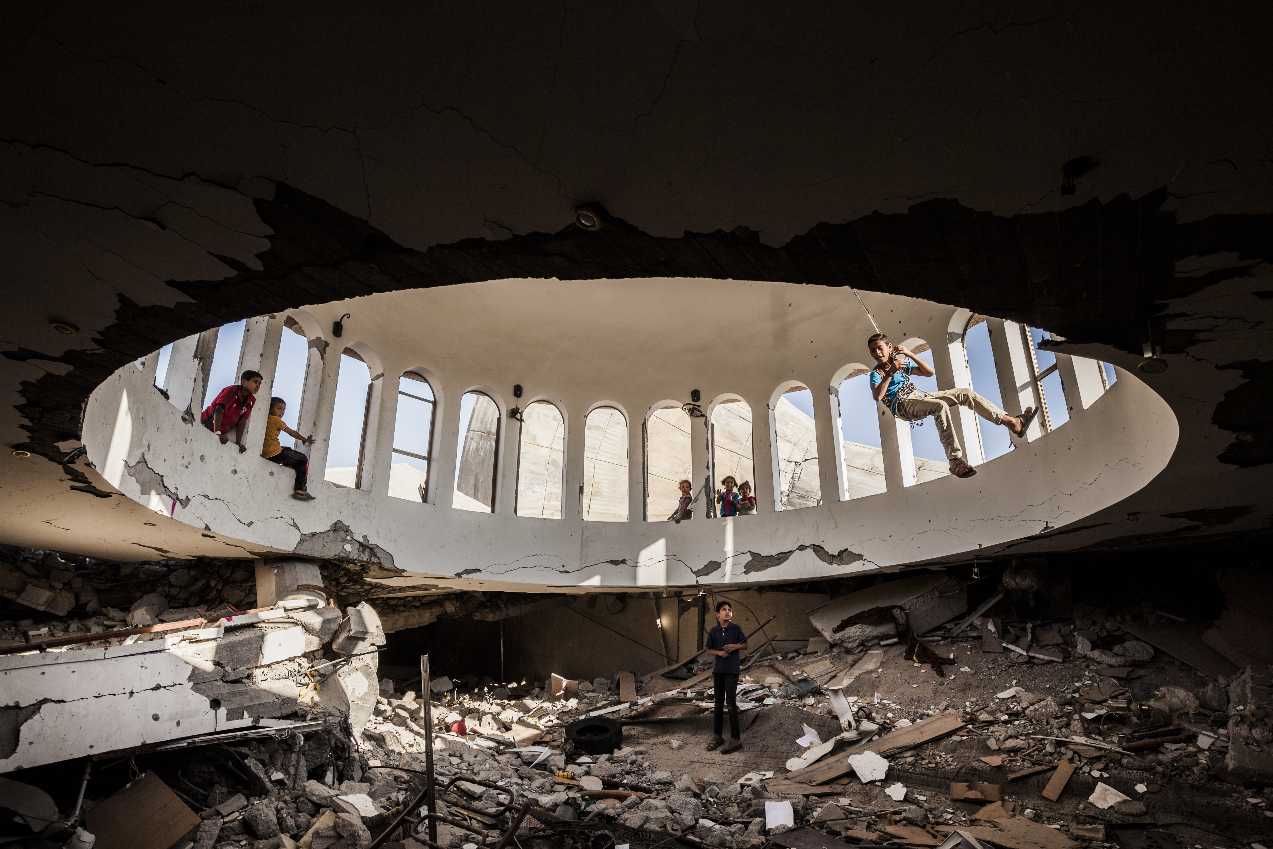 Destroyed mosques in Gaza after the last war against israel : Children play under the dome of the destroyed dome of the Ebad El Rahman mosque in Khuzaa in the south of Gaza.