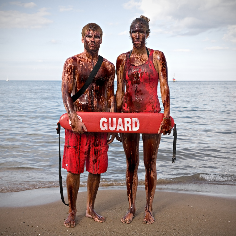 Life Guards : Crude Awakening  ~  Living on the shores of Lake Michigan, I am acutely aware of the disastrous toll the oil spill in the Gulf of Mexico has taken on all forms of life, especially as our beaches opened to the 2010 swimming season. This environmental, social and economic catastrophe highlights a much larger problem that has inflicted untold suffering as we exploit the earth�s resources worldwide.  We are all responsible for leading lives that create demand for unsustainable energy. We are also all responsible for the solution and we must work together to protect the balance of life.