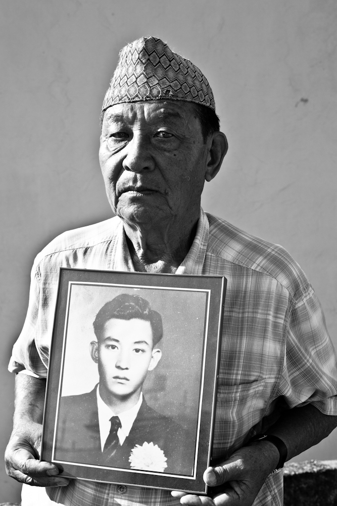 Our Gurkhas : Retired corporal Nar Bahadur Gurung holds up a framed photograph of himself when he first arrived in Singapore in 1953. The 73-year-old served from 1953 - 1973.