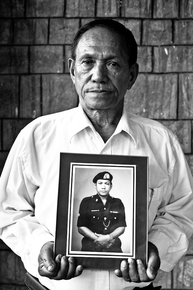 Our Gurkhas : Retired staff sergeant Bhabhindra Bahadur Malla holding a photograph of himself in uniform just before his retirement. The 67-year-old served from 1960 till 1984.