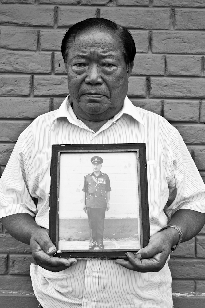 Our Gurkhas : Retired inspector As Bahadur Limbu holds up a framed photograph of himself in uniform, taken in his last few years before retirement. The 75-year-old served from 1956 till 1983.