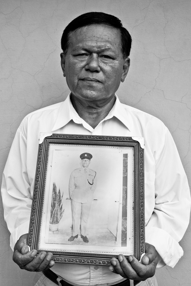 Our Gurkhas : Retired staff sergeant Prem Bahadur Limbu holds on to a framed photograph of his late father retired chief inspector Man Bahadur Limbu. His father was a founding member of the Singapore Gurkha Contingent � the photograph was taken in 1963. The 64-year-old served from 1964 till 1991.