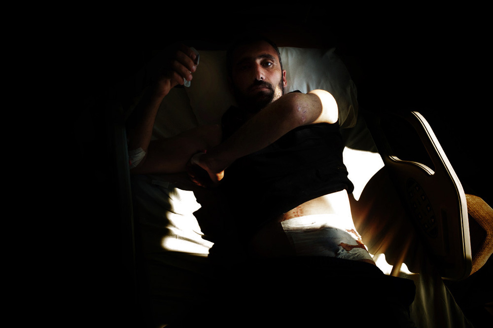 The Longest Arab Spring : A wounded Syrian rebel fighter. Hatay, Turkey