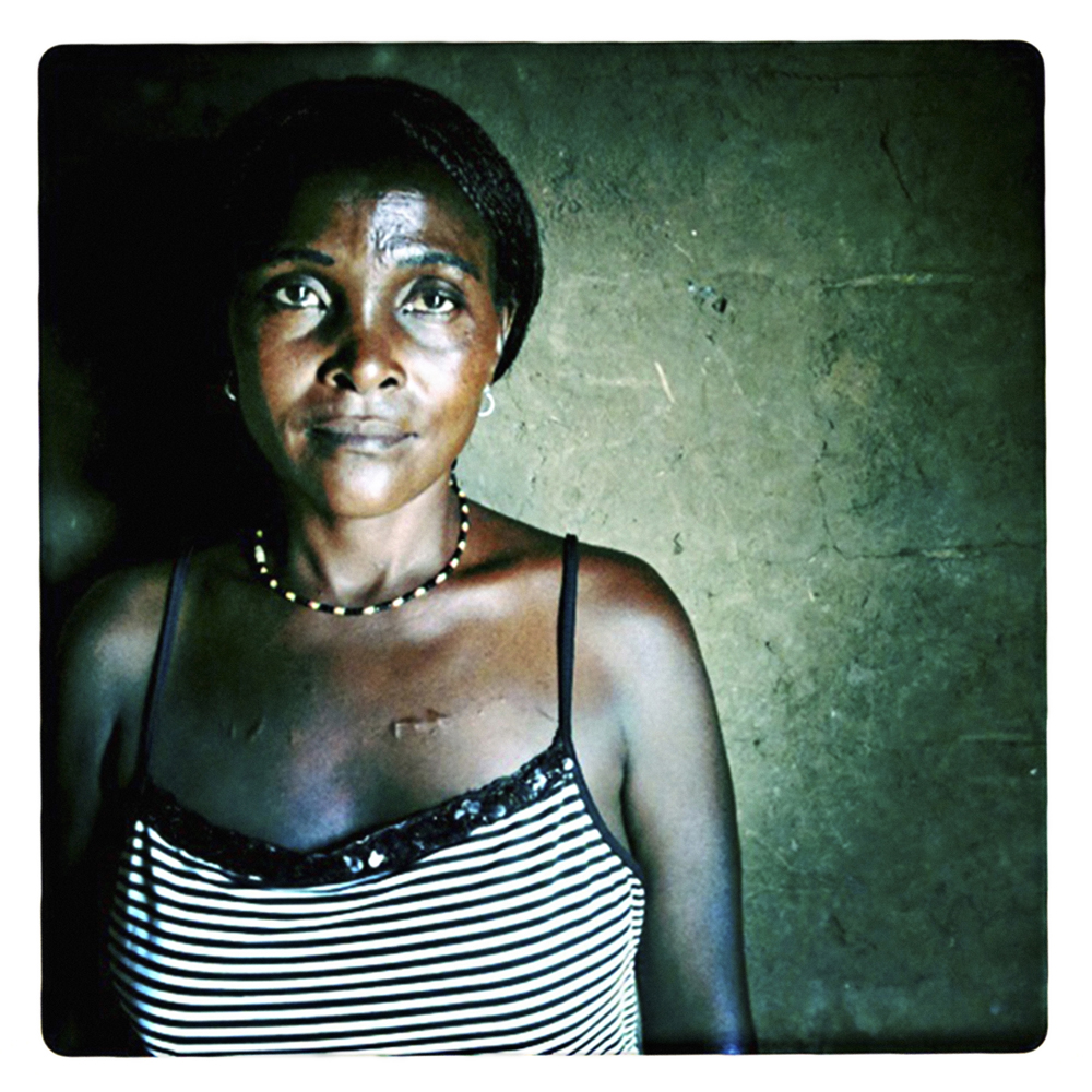 "3 - SCOVIA - from a series the RELUCTANT sex workers : ""Men want rough sex – I think it is to humiliate women.  I am a prisoner of Lake George where there is no escape from the hammering poverty""  SCOVIA  33 years old, widowed twice, 6 children HIV/AIDS+"