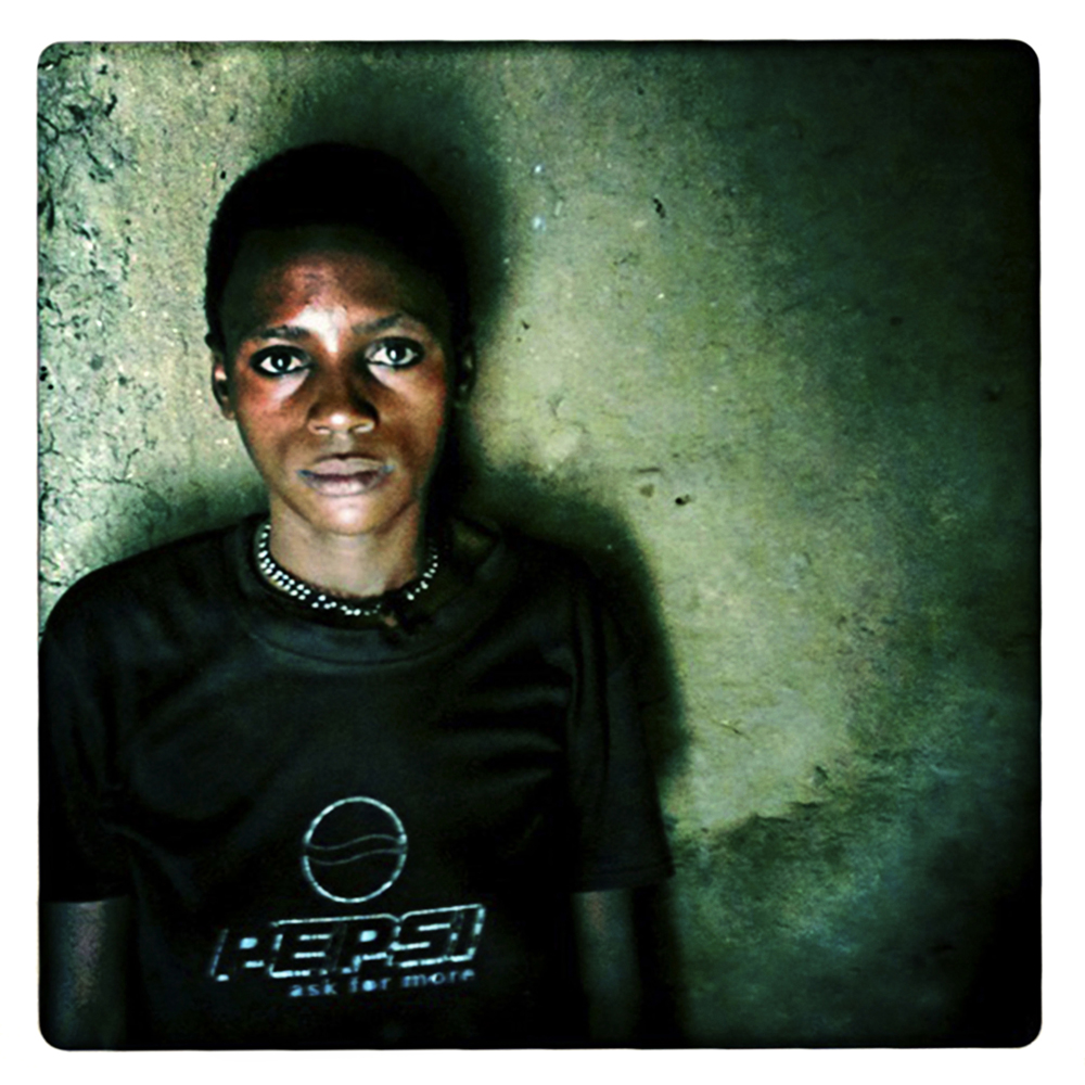 "5 - AVAISI - from a series the RELUCTANT sex workers : 'I sleep on the earthen floor with my young children.  Some days I have no money to buy food, we go to bed hungry.  I am resigned of the world of poverty and AIDS""  AVAISI  26, widowed, 2 children, HIV/AIDS+"