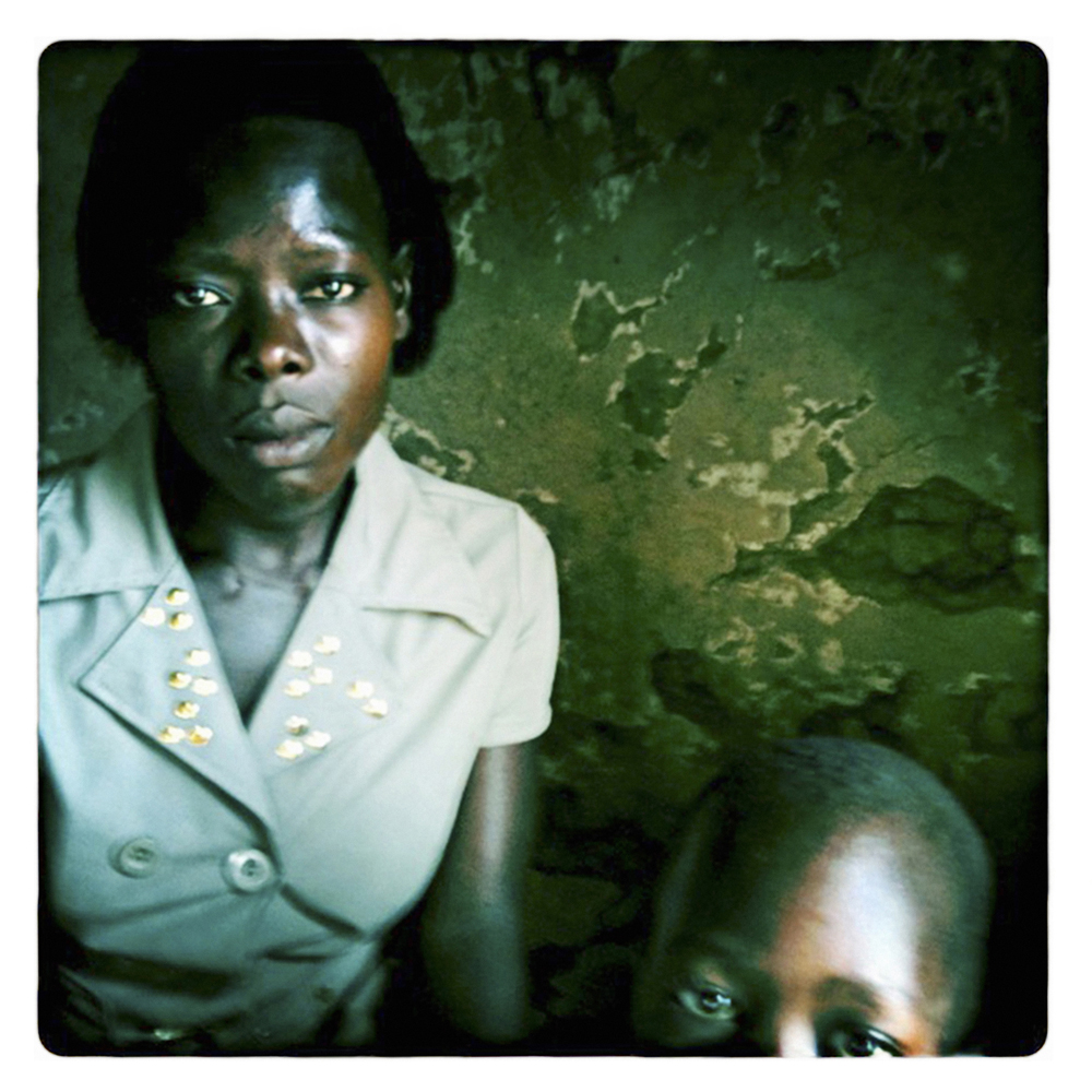 "8 - AGNES - from a series the RELUCTANT sex workers : There are no options to earn money except the sex trade. My clients are fishermen who return to the shores like warriors. They celebrate their survival with alcohol, food and sex.""  AGNES  27, widowed twice, 2 children, HIV/AIDS+"