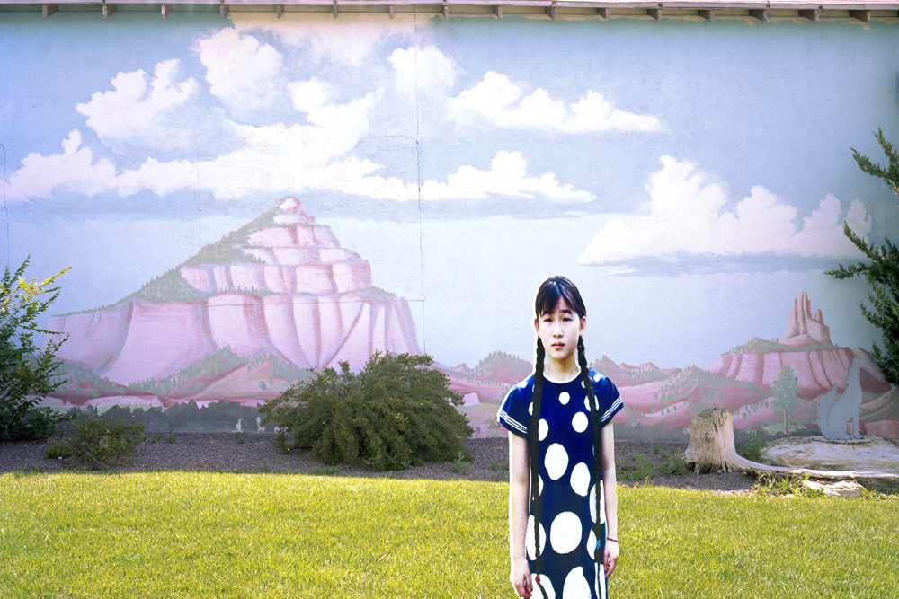 07_ReImagining Eden_Gallup, New Mexico : life-size cutout of girl by nature scene wall mural where both nature and the girl are virtual because she no longer desire real nature to experience and nature is no longer important to her identity