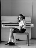 Savanna_Piano Girl : This image is part of a series of Black and White Portraits of school children that is Mentally Disabled(Special needs).Normally we look at people with disablities through the eyes with different perceptions. This image is about her looking back with and intensity that questiones the viewer.
