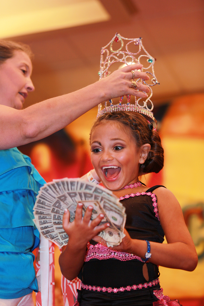 Mary's Pageant :  Mary Brunner, age 8, being crowned as the Ultimate Glitz winner at the Big Top Pageant at the Holiday Inn in Harrisburg, Pennsylvania on August 12, 2012.  Mary has been competing in pageants since she was five.