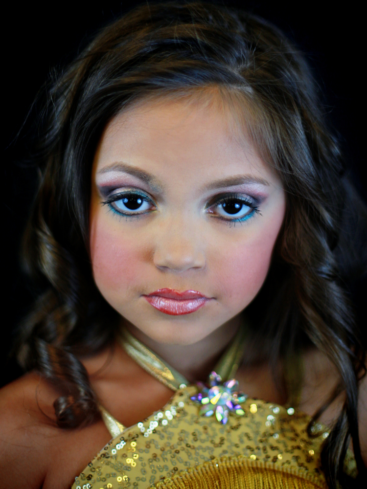 Mary's Pageant : Mary Brunner, age 8, posing for a portrait  during the Angel Face Nationals in Liverpool, New York on October 27, 2012. Each year as many as 100,000 children under the age of 12 participate in U.S. child beauty pageants, and it has recently become a billion-dollar industry.