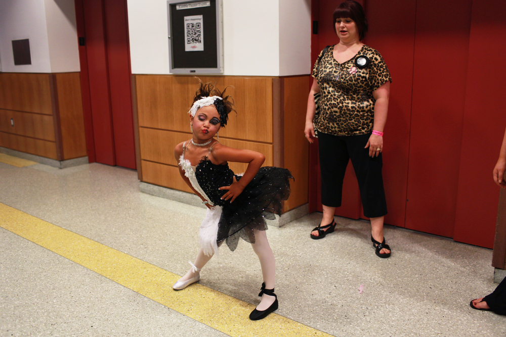 Mary's Pageant : Mary Brunner, age 8, receiving last minute coaching by her mother Dana before performing her Black Swan routine at the Candy Land beauty pageant at the Kimble theatre in Brooklyn, New York on July 21, 2012. Each year as many as 100,000 children under the age of 12 participate in U.S. child beauty pageants, and it has recently become a billion-dollar industry.