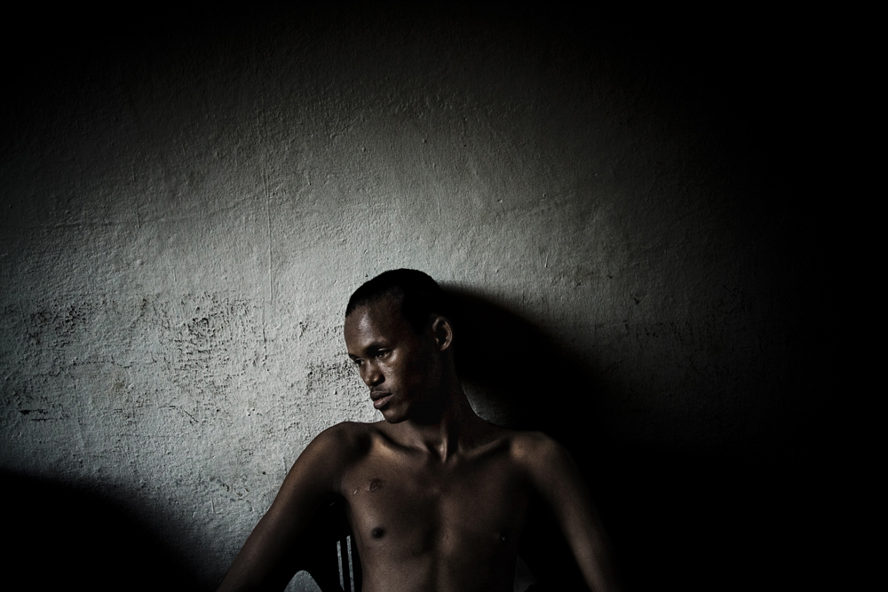 Struggle for a normal life : ITALY. 2011. Ahmed Abdi, arrived in Italy in April 2011. He bears on the right pectoral the sign of a plastic bullet that hit him during an escape attempt from the Libyan prisons, where he spent six years.
