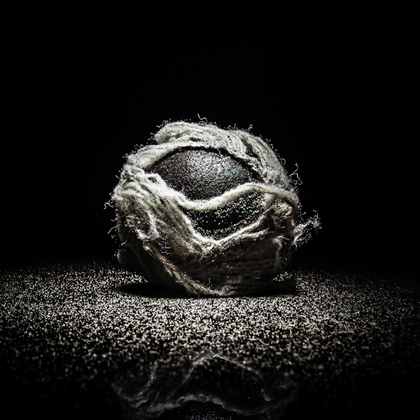 Tennis Ball : A selection from a personal project about plastic garbage in the ocean.  I wanted to idealize the objects found on the beach, pointing the attention to the fact that after being in between storms, waves and hot sun, these object are still there, partially destroy but still around us. They will not disappear by themselves unsell we decide to take care of our beaches and oceans.