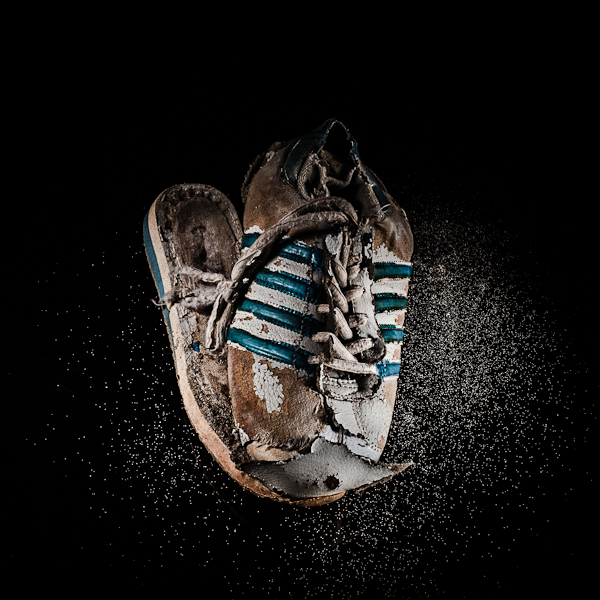 Tennis Shoes : A selection from a personal project about plastic garbage in the ocean.  I wanted to idealize the objects found on the beach, pointing the attention to the fact that after being in between storms, waves and hot sun, these object are still there, partially destroy but still around us. They will not disappear by themselves unsell we decide to take care of our beaches and oceans.