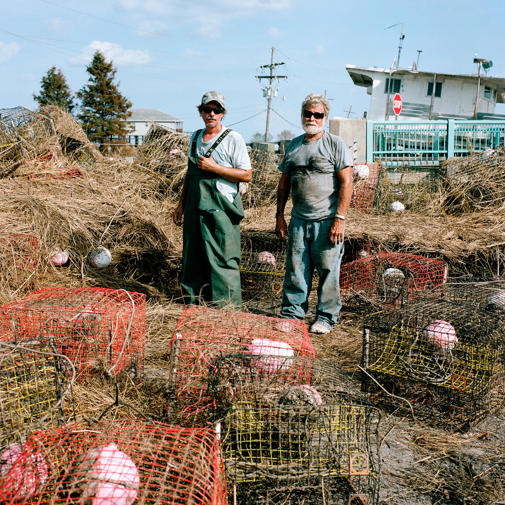 "Preacher"" and son, Alan Squires, commercial crabbers. Hopedale, LA 2012 : Recovering crab traps after Hurricane Isaac to ""get back to work"" the following morning."