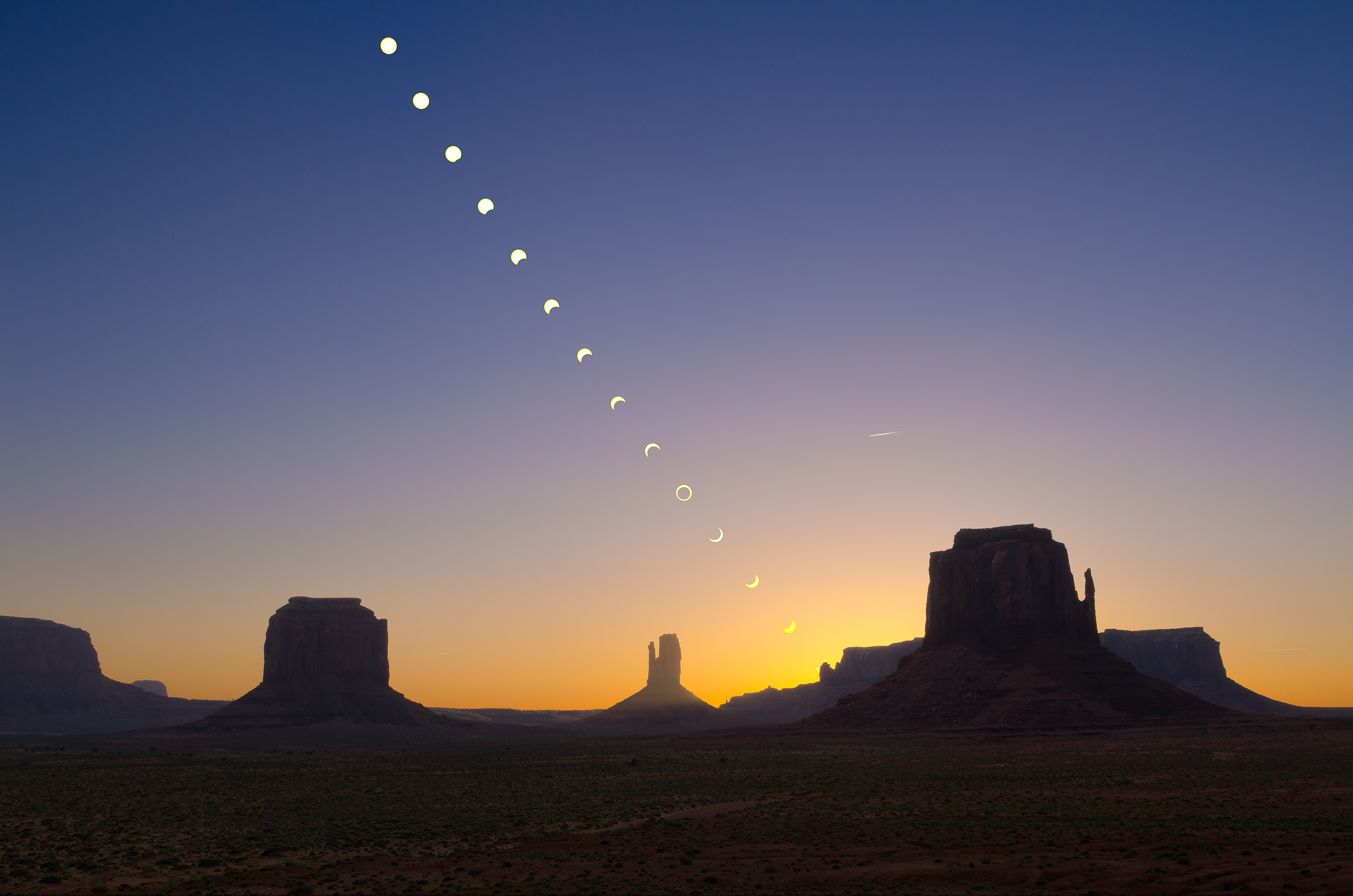 Eclipse; Monumet Valley, Arizona : Time-lapse showing phases of annular eclipse at Monument Valley, Arizona