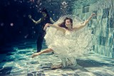 Dancing in water : couple dancing and floating underwater